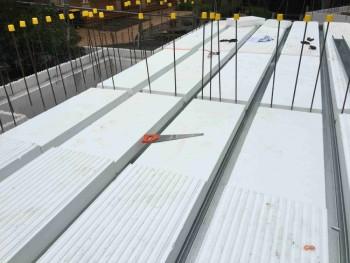 Suspended slab flooring system